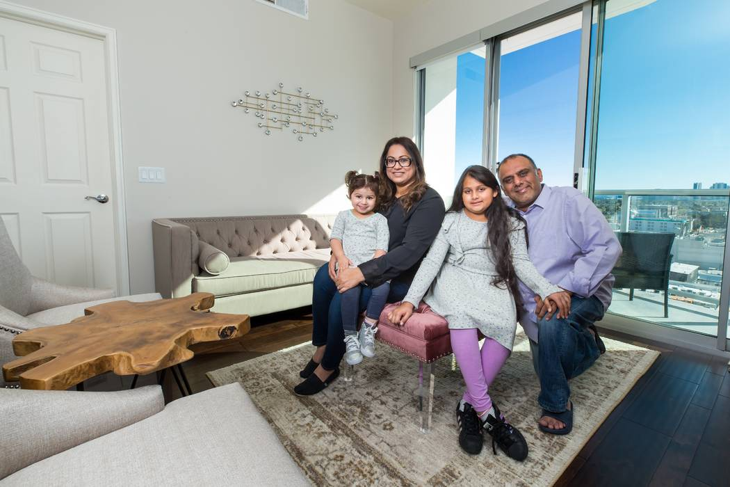 Family of four sitting in their living room at The Ogden