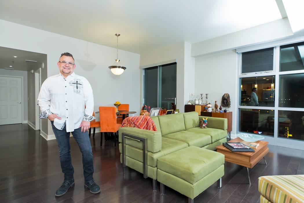 Donavan Delgado standing in his living room in his home at The Ogden